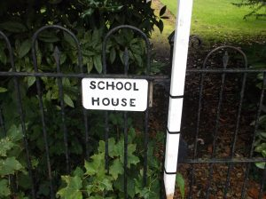 Old School House Sign - Source: Wiki Commons